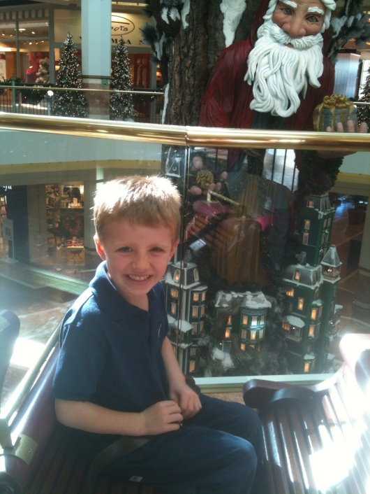 Here's T this season (December 2012) at the South Coast Plaza Holiday Train. Santa's watching you, T!
