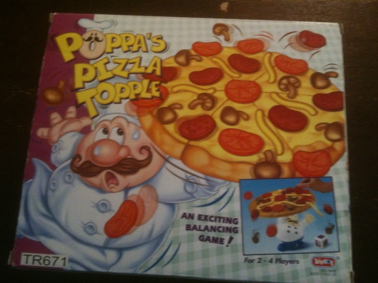 """Poppa's Pizza Topple"" is another balance-themed board game for the younger set. We received this sometime around when T was 2 or 3 years old."