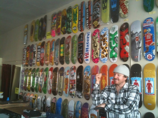 Owner Tim Scanlon decks the walls of Long Beach Skate with the latest designs.