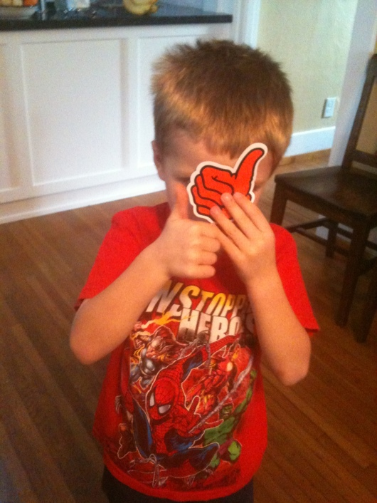 Thumbs Up! T loves his new sticker from Long Beach Skate.