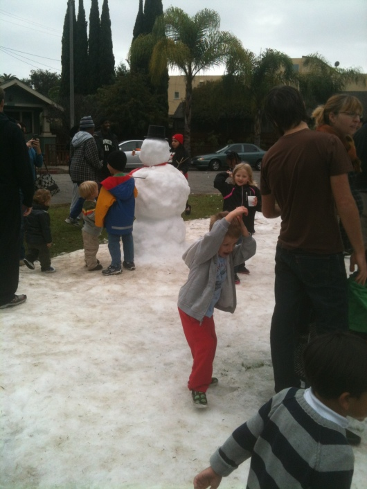 """T on the receiving end of a snow ball or two at Saturday's """"Snow Day"""" in Rose Park (Long Beach, CA)."""