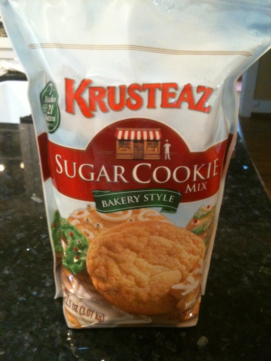 Krusteaz makes this Costco-sized bag of their sugar cookie mix during the holiday season. The great thing is if you can't bake your way through the 21 dozen by New Year's, they're just plain sugar cookies that can be made at Valentine's Day, Easter, birthdays, etc. Don't let the holiday packaging fool you!