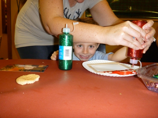 T peeking out for a photo opp during craft time at Emigh Dental Care's annual Santa event.