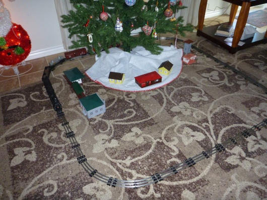 The restored Lionel choo-chooing its way around the tree at T's grandparents' house. This was a big surprise for all of us this season!