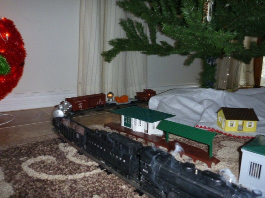 Yes, the train has a working smoke stack and also came with its own set of Plasticville houses and buildings, too!