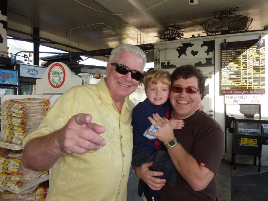 Huell Howser and his trademark photo pose.