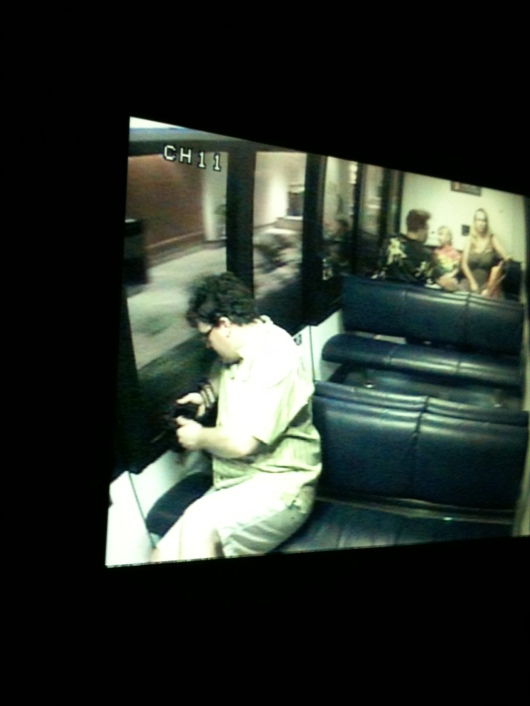 """There's C on the """"little TV,"""" what T calls the security cameras on the Hilton Waikoloa's monorail. T watched the closed-circuit TVs more than anything as he """"drove"""" the train. This was on our previous trip in Spring 2012."""