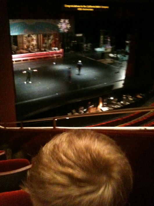 T enjoys pre-show warm-ups before his first attendance at The Nutcracker.