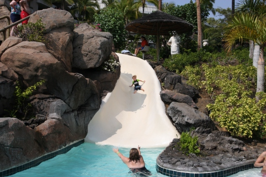 T on his way down the longer of the three slides at the Kohala Pool (taken Spring 2012).
