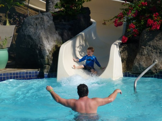 T exits the Kona Pool water slide for the first time on our recent trip to the Hilton Waikoloa Village Resort.
