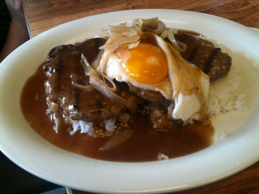 "Hawaiian Style Cafe's ""loco moco"" plate: Two hamburger patties with rice, sunny-side up egg, onions, and gravy. Oh-so-ono!"
