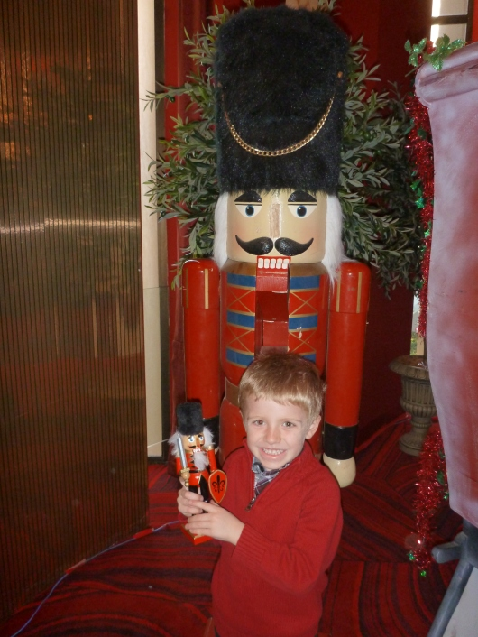 T loves his new soldier, er, Nutcracker. Sadly we later learned it doesn't really crack nuts, but that's OK.