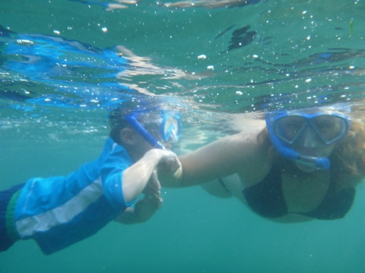 T and I snorkeling the Big Island at the Hilton Waikoloa Village Resort's lagoon.
