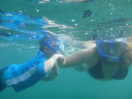 T and I snorkeling the Big Island at the Hilton Waikoloa Village Resort's lagoon.