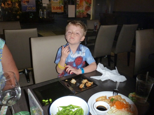 T gobbles up gyoza at the Aloha Wine Bar.