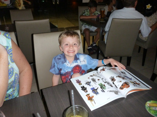 While C and I enjoyed a lovely New Year's cocktail hour and leisurely meal, T did his LEGO Star Wars sticker book. Atta boy, T!