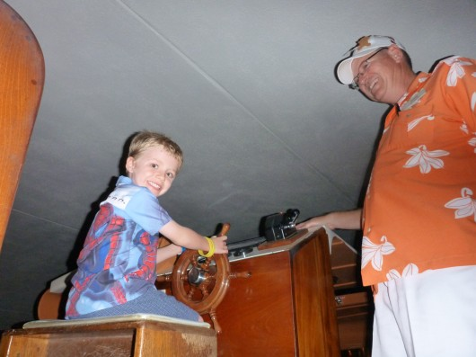 T and his transportation friend Andrew aboard a canal boat at the Hilton Waikoloa.