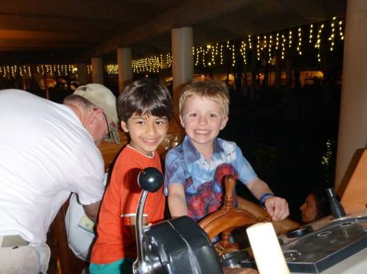 T and N driving the boat at the Hilton Waikoloa Village Resort.