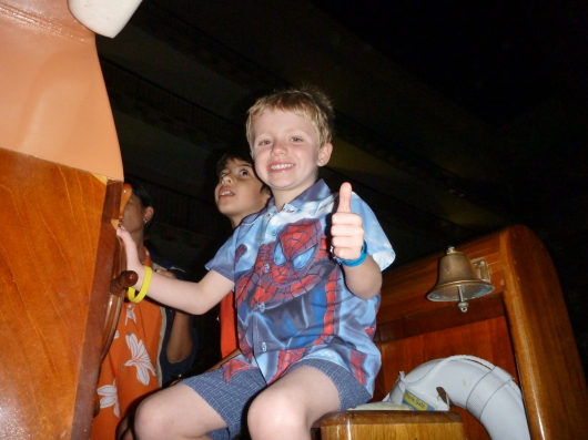 """T gives the boat the go-sign as he and a """"vacation friend"""" co-captain a canal boat at the Hilton Waikoloa."""