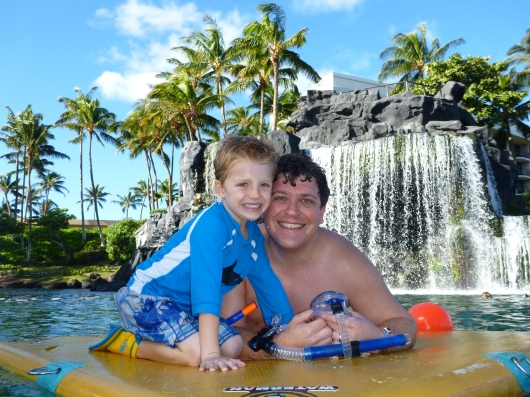 My boys on a snorkeling break on the raft in the Hilton Waikoloa's lagoon.