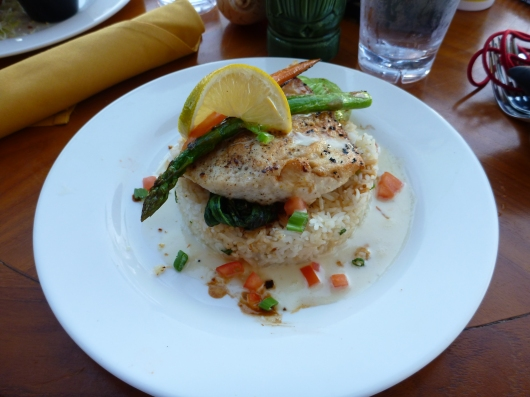 A local pink snapper over baby bok choi and a pillow of rice, the daily special at Lava Lava Beach Club.