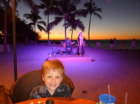 T with the live musician and hula dancer behind him at sunset at the Lava Lava Beach Club.