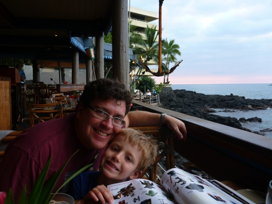 C and T waiting for food at Huggo's in Kona, HI (Big Island).