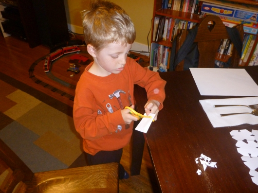 T making his snowflake for Sandy Hook Elementary. He just thinks it's homework, and that's fine with me.