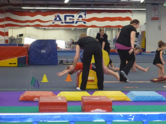 "T gets a little help with his ""superman"" move during his trial class at AGA."