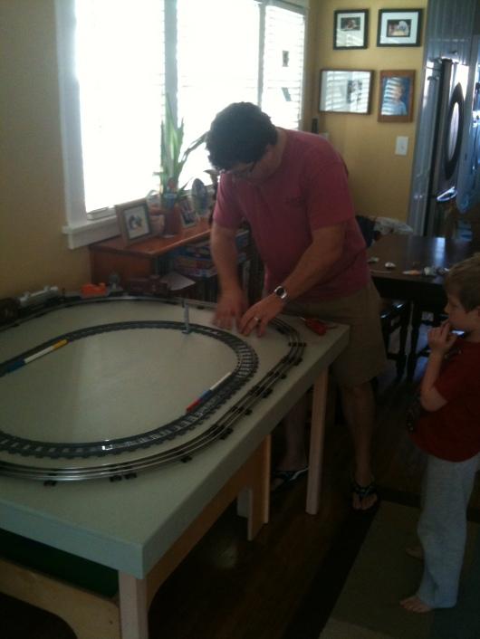 C adjusting the concentric train sets, LEGO inside, Lionel outside.