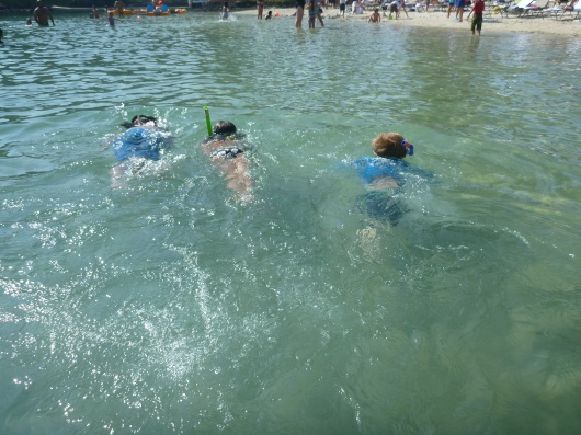 "T with his ""snorkeling friends"" while on vacation earlier this month."