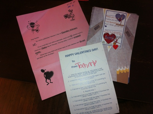 T's class Valentine card this year was a paper airplane along with a free pass for a gymnastics trial class at his gym. Most give candy, and we give the activities post-candy I suppose!