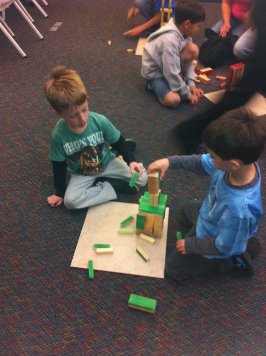 T and his buddy building a tower together.