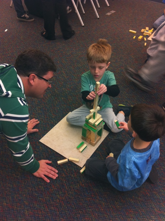 C the engineer helping T and a buddy build a tall tower.