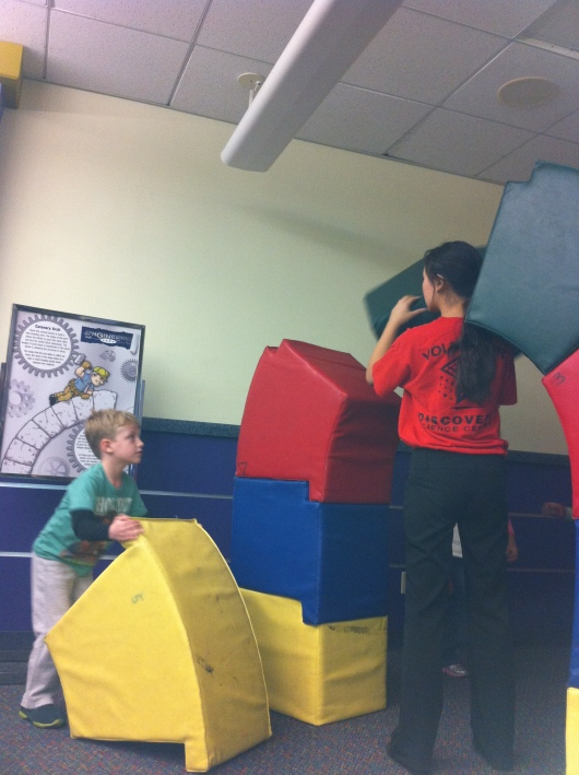 T helps to build an arch at DSC's Engineers Week events Monday.
