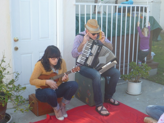 "Hello? Who's this? Andrew answers a ""banana phone"" while Polly plays along to the kiddie (and parent) crowd. This duo is music to ears of all ages on LA's West Side."