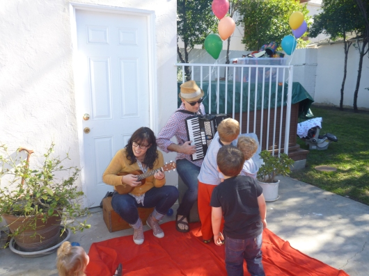 Kids lined up to play Andrew's (of Andrew & Polly) accordion. Audience involvement is what makes the Andrew & Polly shows so engaging for kids and parents alike.