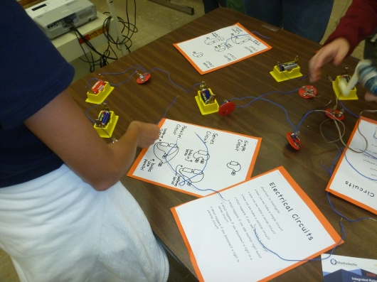 An electrical science center invited kids and adults to plug away at circuitry.