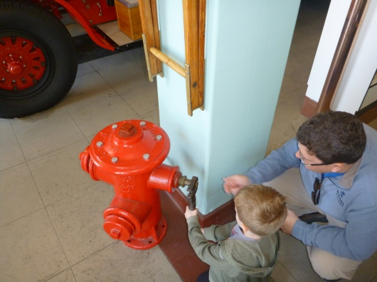 C and T check out an old fire hydrant on display at the LAFD Harbor Museum.