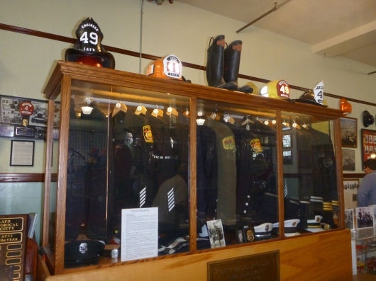 Uniforms over the years on display at LAFD Harbor Museum.