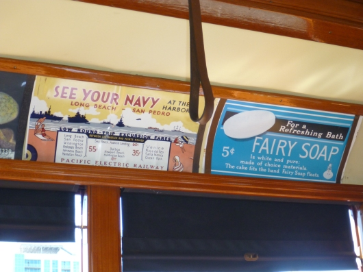 Old advertisements on display in the newly restored and replica Red Cars in San Pedro, CA.