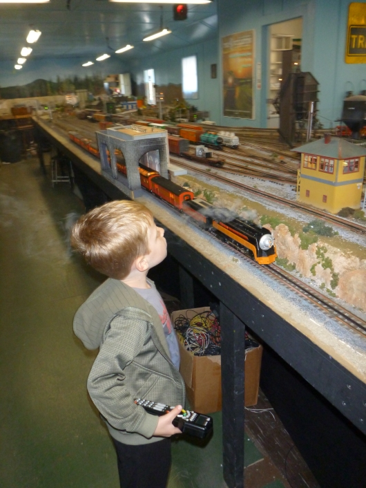 T loved watching the steamie clickity-clacking down the tracks at AGHR's clubhouse!