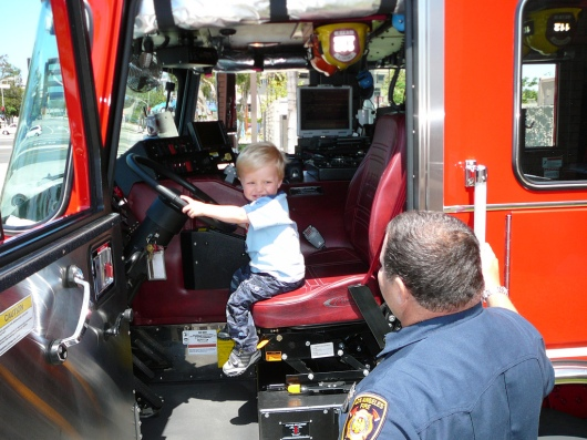 T in a fire truck at station #112 near Fireboat #2 in San Pedro just across the street from the LAFD Harbor Museum (taken June 2009).