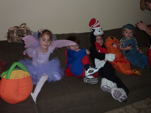 I could not find a photo of anything Dr. Seuss-related in our archives, which is weird considering T used to have all of these Dr. Seuss T-shirts. However, I did find this wonderful photo from Halloween 2009. One of T's friends was the Cat-in-the-Hat, her younger brother the Fish, and the parents (not pictured) were the Things.