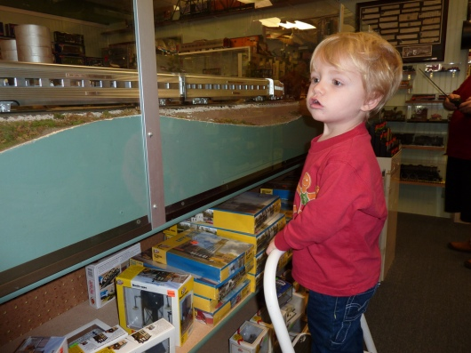 T watching the trains chug by at Dynamic Hobbies. He's 2-years-old in this photo (taken December 2009).