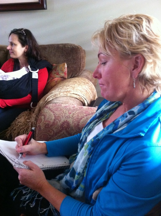 "A mom takes notes during Kathy Salazar's ""Practical Parent Talk"" Friday."