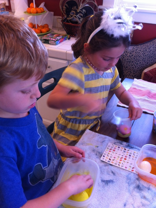 T and our neighbor pal dyeing eggs together.