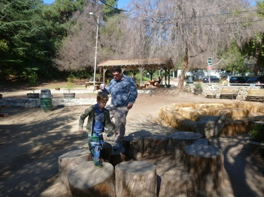 I thought our snack stop was a break, but my boys just couldn't resist the tree stumps and hay bales at The Trails Cafe.