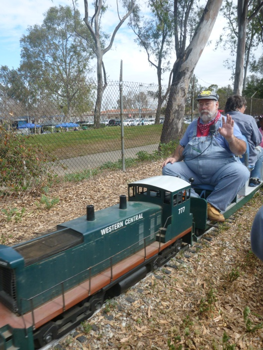 A very lucky shot of the passing driver while riding on the passing train at Southern California Live Steamers.