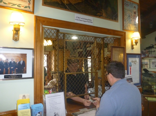 "Visitors get their museum tickets at the ""ticket counter"" inside of the Lomita Railroad Museum."